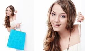 手拿购物袋的美女人物高清摄影图片