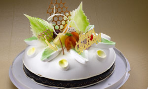 蜜诺多拉生日蛋糕摄影图片