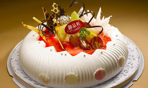 南瓜形状生日蛋糕摄影图片