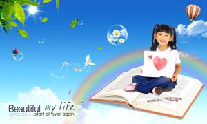 坐在打开的书本上的小女孩PSD分层素材