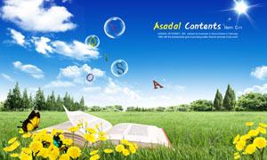 草地上翻开的书本与黄色鲜花PSD分层素材
