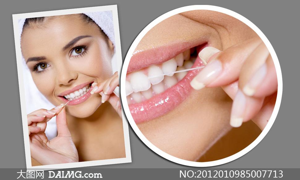 用牙线清理牙齿的美女人物高清摄影图片