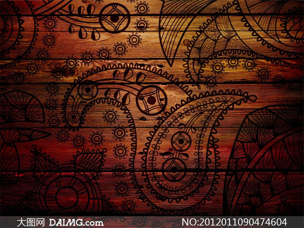 腰果花纹图案装饰的木板高清摄影图片