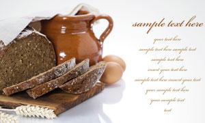 切开的黑面包与瓦罐高清摄影图片