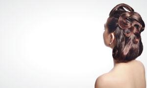 美女盘头发型侧面展示高清摄影图片