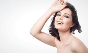把手放在额头的外国美女高清摄影图片