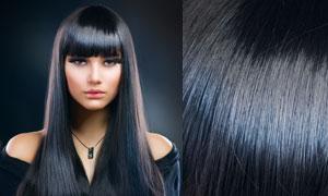 身穿露肩装的黑色秀发美女人物高清摄影图片