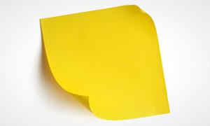 卷角效果的黄色便签纸高清摄影图片