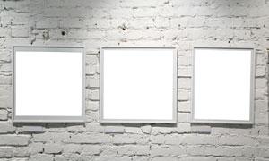 灰白色上的挂着的空白相框高清摄影图片
