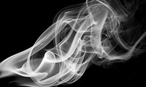 黑色背景上的白色烟雾摄影高清图片