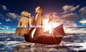 阳光下航行的帆船