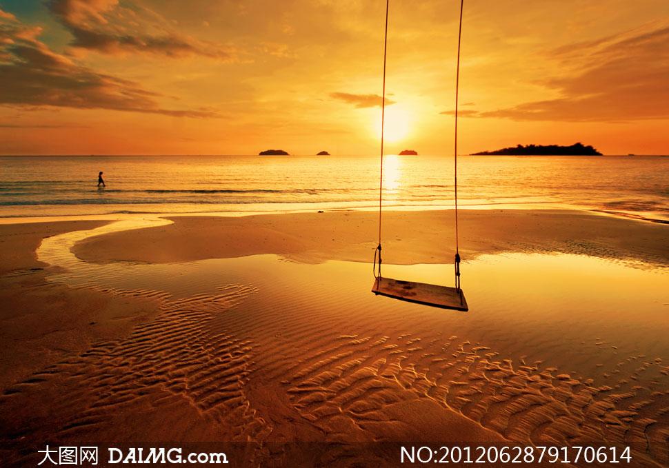 落日余晖下的大海秋千摄影高清图片