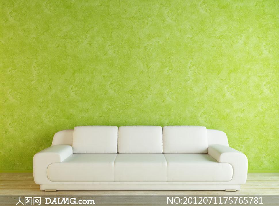 _绿色墙壁与l形组合沙发高清图片