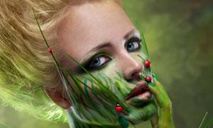 涂绿色颜料的彩绘美女摄影高清图片