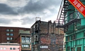矗立在街区的建筑影楼摄影背景图片