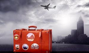 红色旅行箱与飞机大楼摄影高清图片