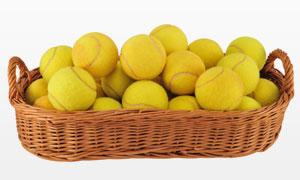 盛放在篮子里的网球摄影高清图片