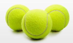 三个摆放整齐的网球摄影高清图片