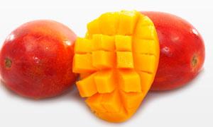 露出新鲜果肉的苹果芒摄影高清图片