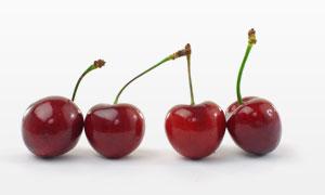 四个排列整齐的红樱桃摄影高清图片