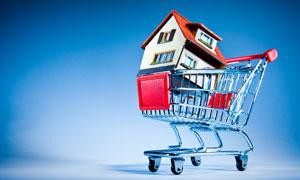 放在购物车里的小房子创意高清图片
