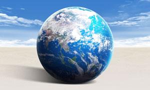 沙灘上的地球創意設計PSD分層素材