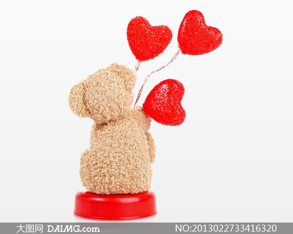 拿心形棒棒糖的毛毛熊摄影高清图片 - 大图网设计素材