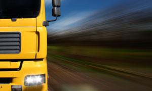 黄色大型卡车特写动感摄影高清图片