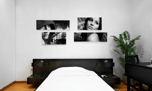 卧室房间墙壁上的画框摄影高清图片