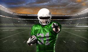 穿绿色球衣的橄榄球员摄影高清图片