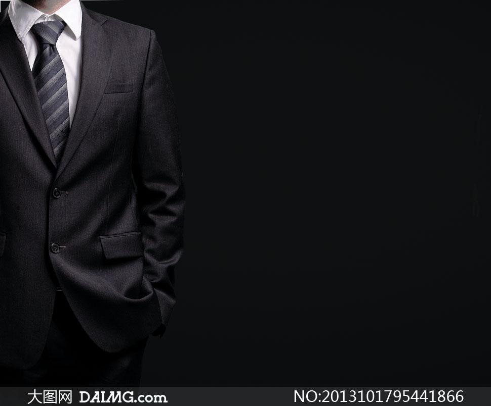 黑色背景前的男人局部摄影高清图片