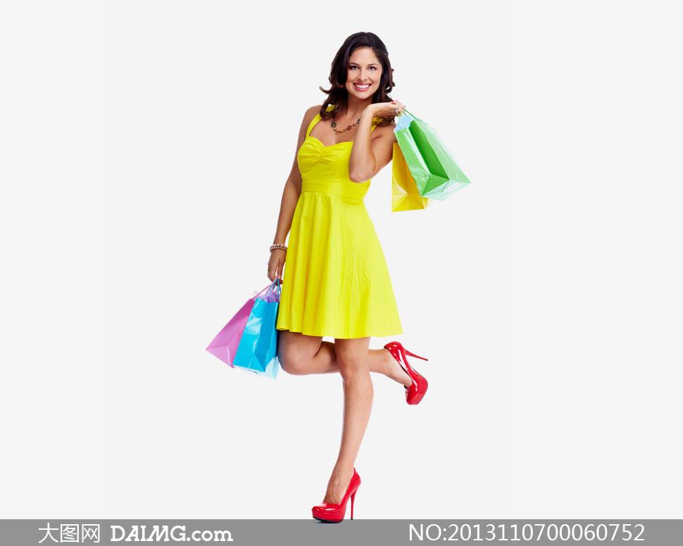 穿黄裙子高跟鞋的美女摄影高清图片