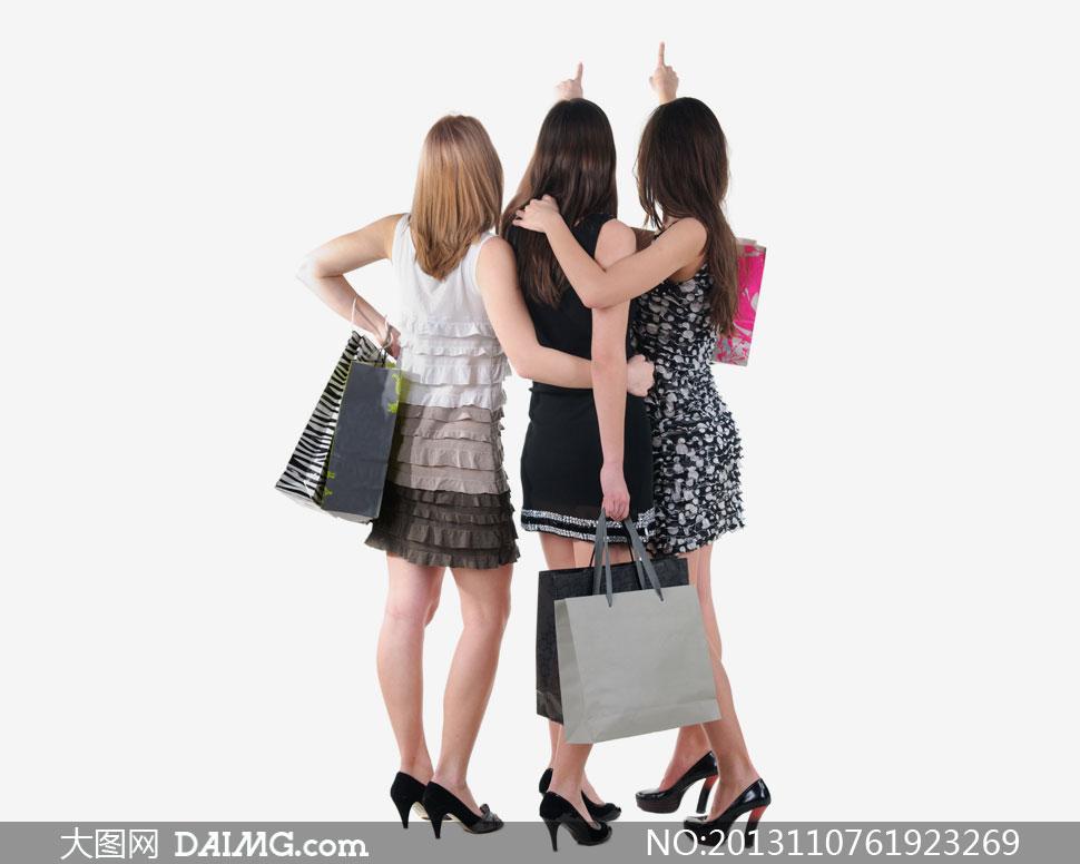 三个购物美女背影手势摄影高清图片