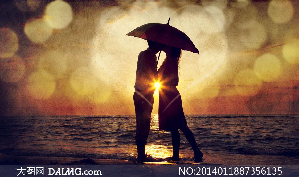 黄昏在海边的情侣人物摄影高清图片