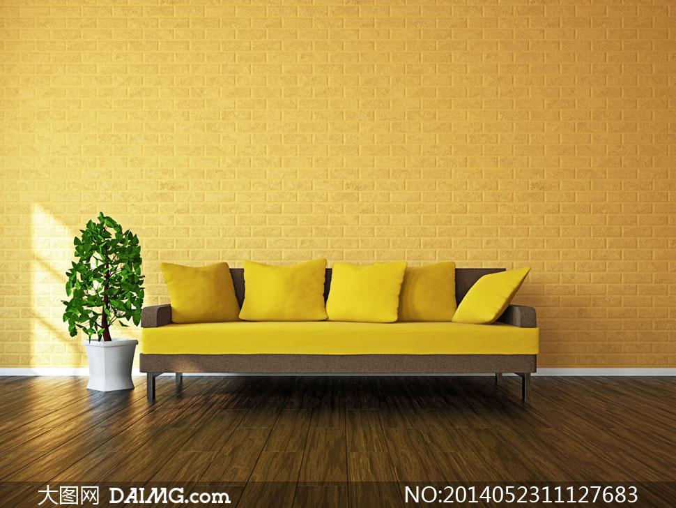 靠墙放着的沙发与植物摄影高清图片