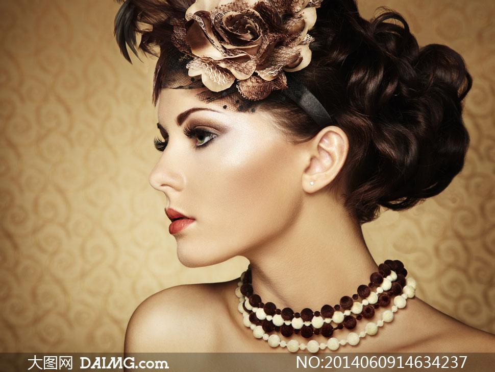 浓妆盘发美女人物侧面摄影高清图片
