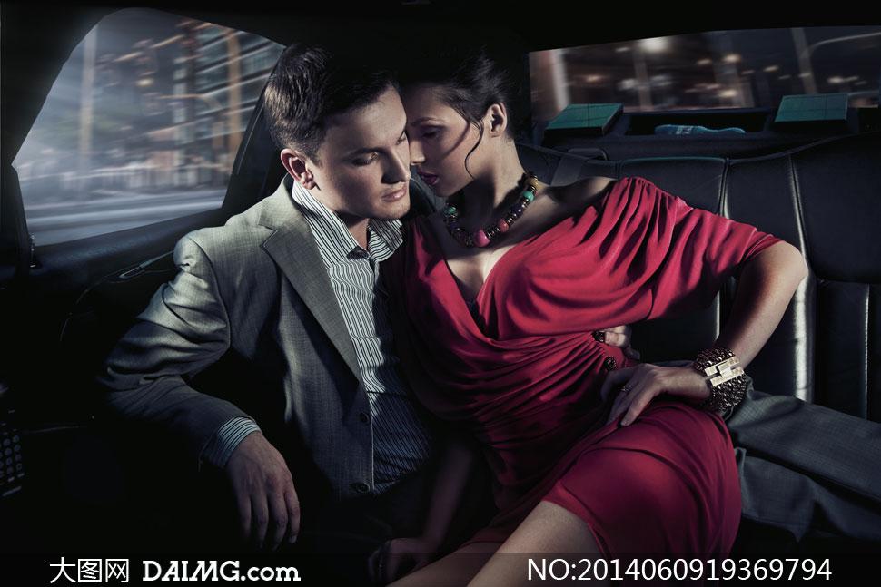 西装男与性感红衣美女摄影高清图片 大图网设
