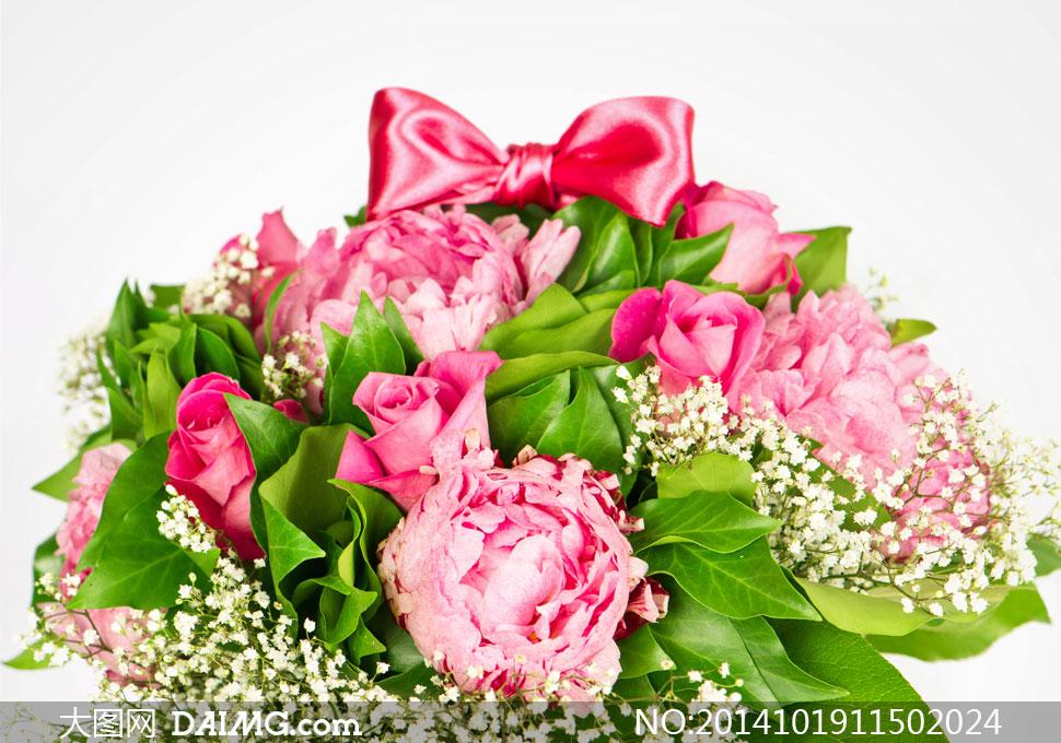 关键词: 高清摄影大图图片素材花朵花卉鲜花花束蝴蝶结红花绿叶