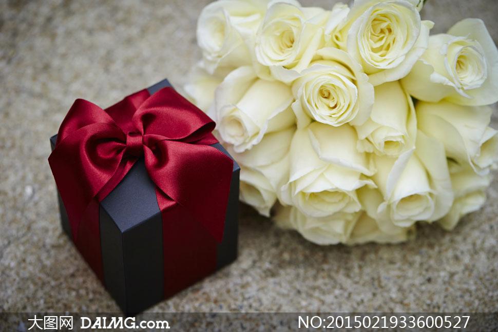 玫瑰花束与精致礼物盒摄影高清图片