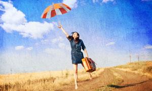 撑着雨伞的做飞翔状的美女高清图片