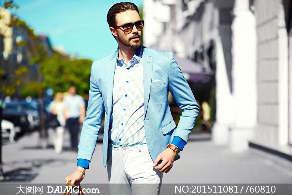 戴着太阳镜的西装男人摄影高清图片