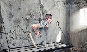 冲破水泥墙束缚的男人创意高清图片