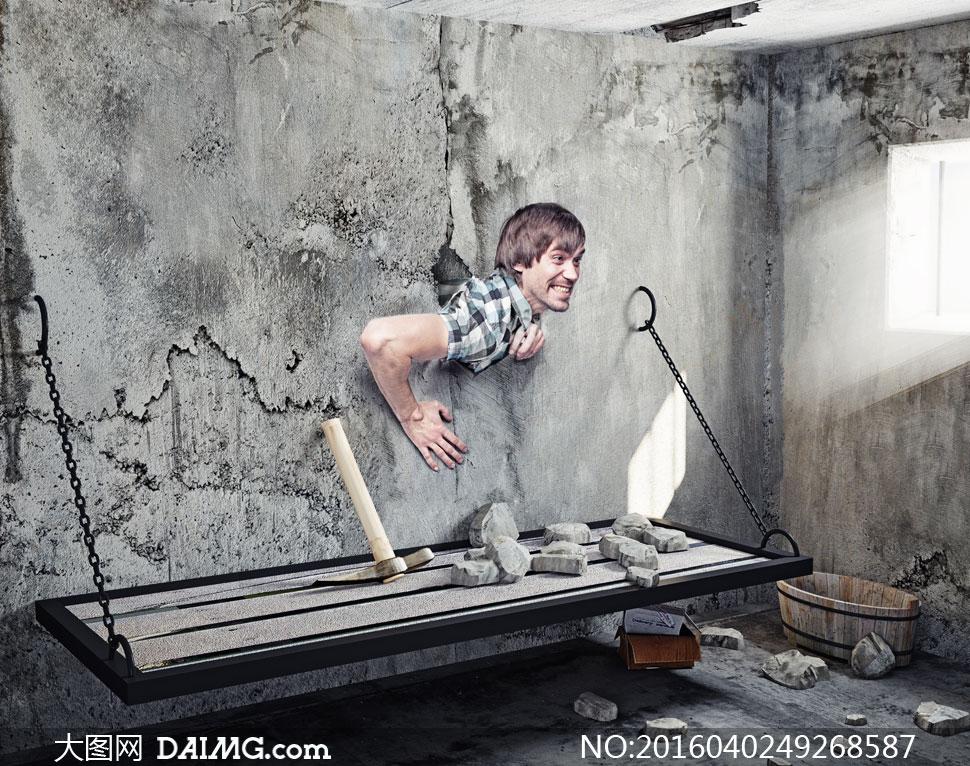 冲破水泥墙束缚的男人创意高清图片图片