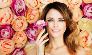 手里拿着一朵花的美女摄影高清图片