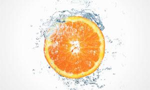 水花与切开的橙子特写摄影高清图片