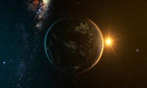 宇宙中的地球与升起的太阳高清图片