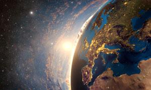 星空地球與升起的太陽攝影高清圖片