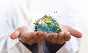 捧在手心里的建筑物地球等创意图片
