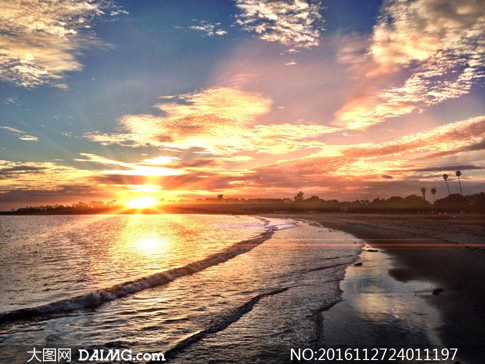 夕阳霞光下的大海风景摄影高清图片
