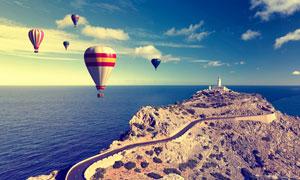 蓝天白云与海面上的热气球高清图片